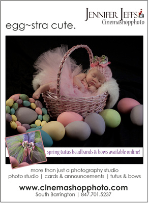 baby girl with pink tutu in easter basket with colored eggs